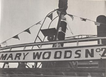 1968 – Mary Woods Number 2 with Sign and Flags