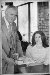 1960's – Wes Hall and a Customer at the Minute Man Opening