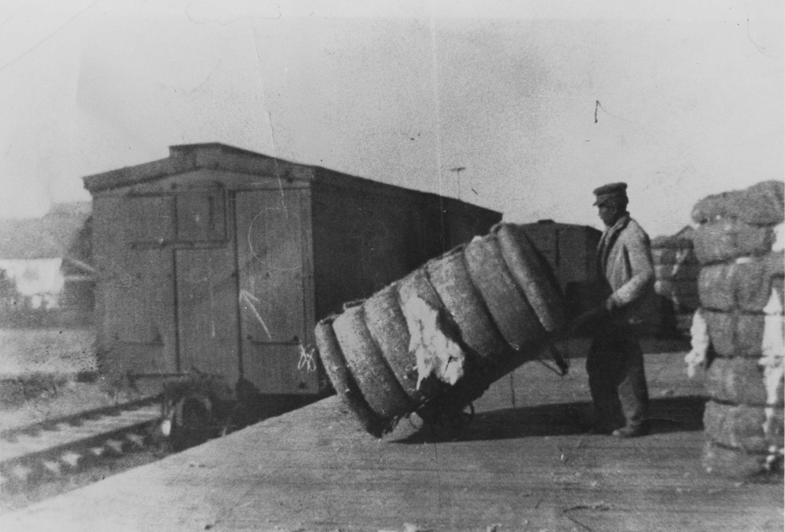 1910's – Loading cotton at railroad depot, Tupelo